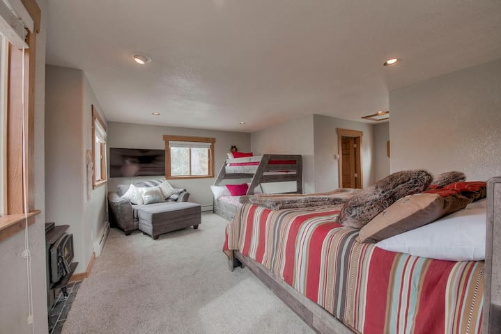 Master bedroom with king bed, large TV and bunks