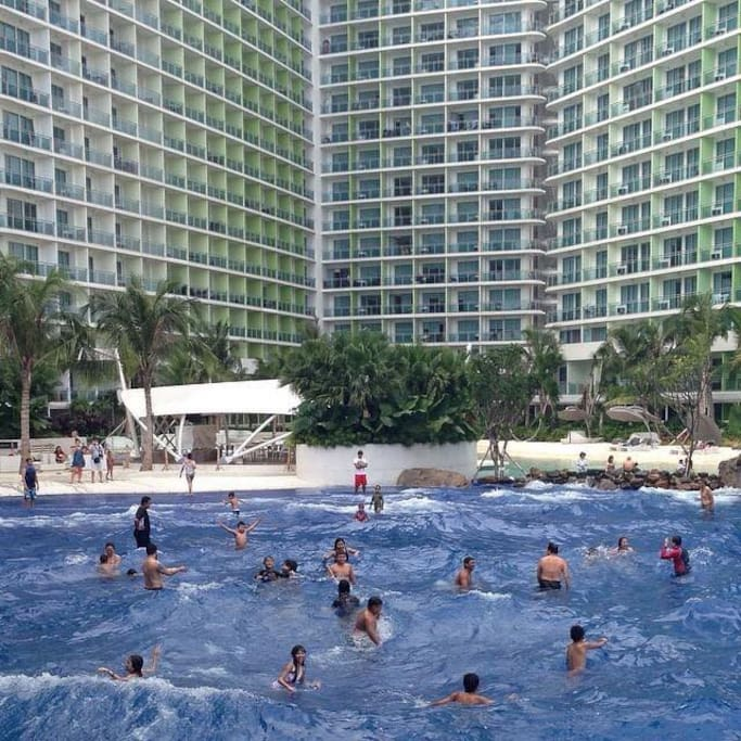 Guests swimming at the wave pool