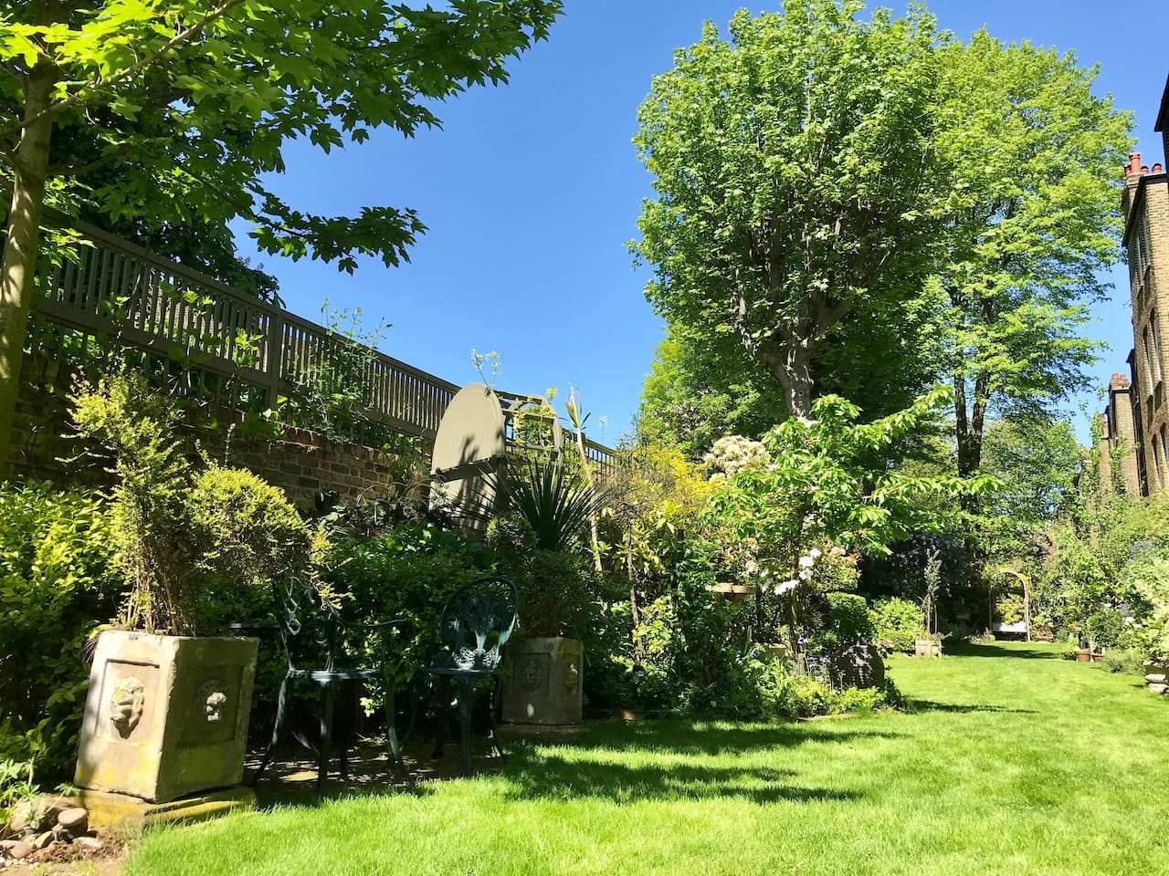 """Winner 2018 """"Best Garden in Chelsea""""   Beautiful award-winning private garden with fish ponds and water fountains (this is just half of it!)   It's maintained daily by a gardener and is a peaceful haven in London.  The photos really don't do the garden justice, it was the biggest selling point for me!"""
