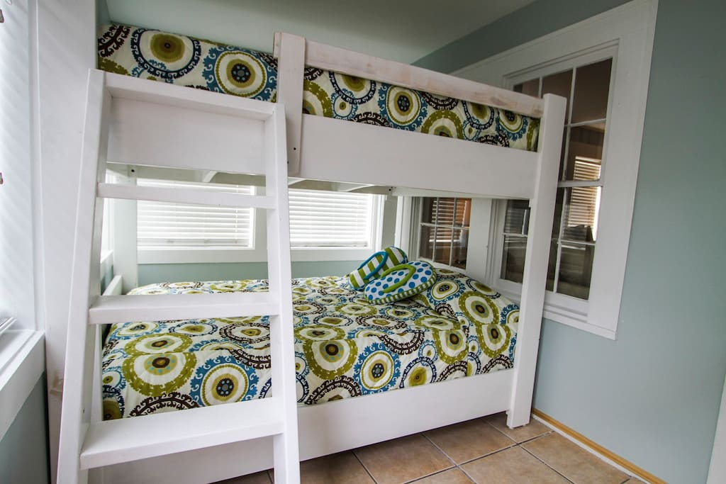 Bunk area right off entrance. Bunks are full size beds.