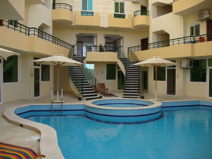 Clean apartment with swimming pool and free beach.