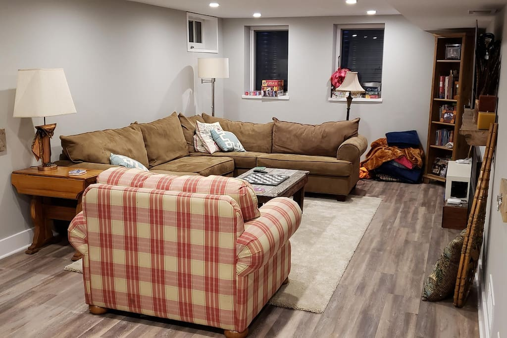 Half of the studio apartment.  The sectional couch pulls out into a queen size bed.  The plaid chair pulls out to a single bed.