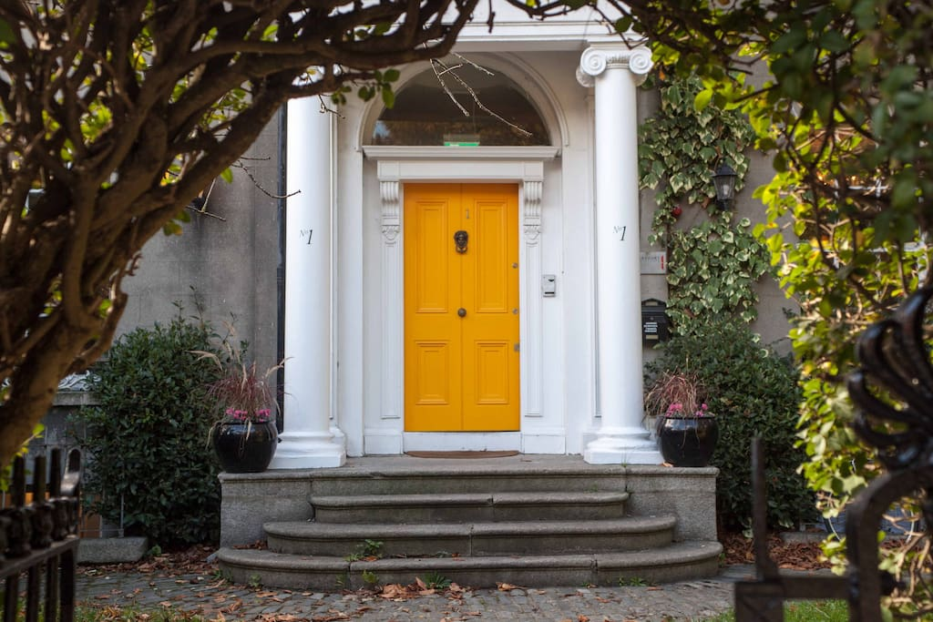 Our yellow door. Our building dates from 1830. It is the only regency period terrace remaining in Ireland.