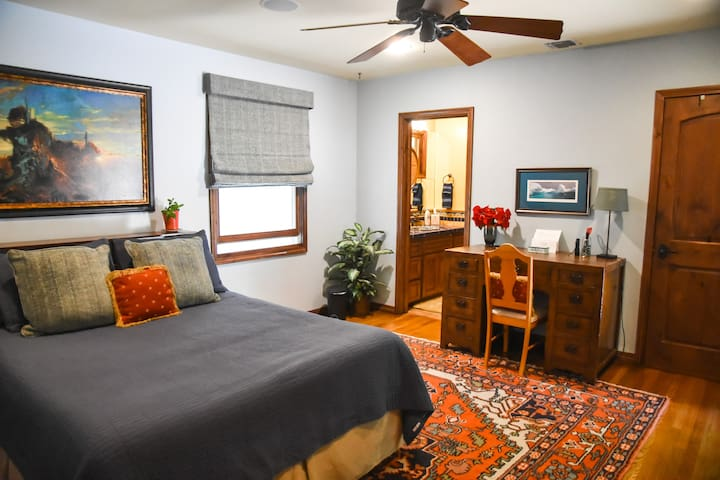 Spacious bedroom with queen size bed, private bath and walk-in closet with mini-fridge, electric kettle and more.