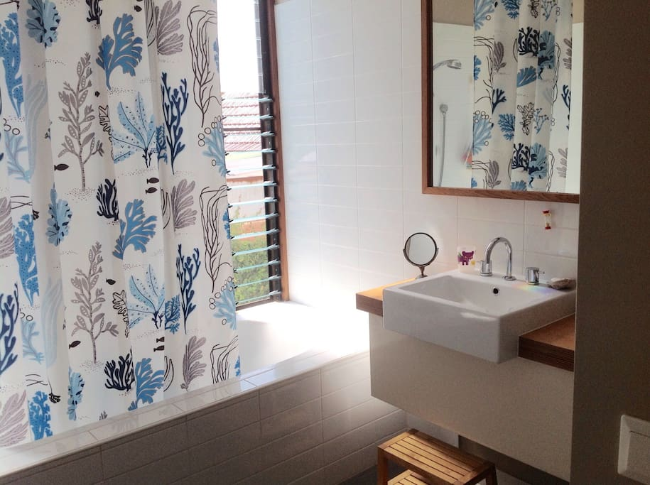 upstairs bathroom with bath tub