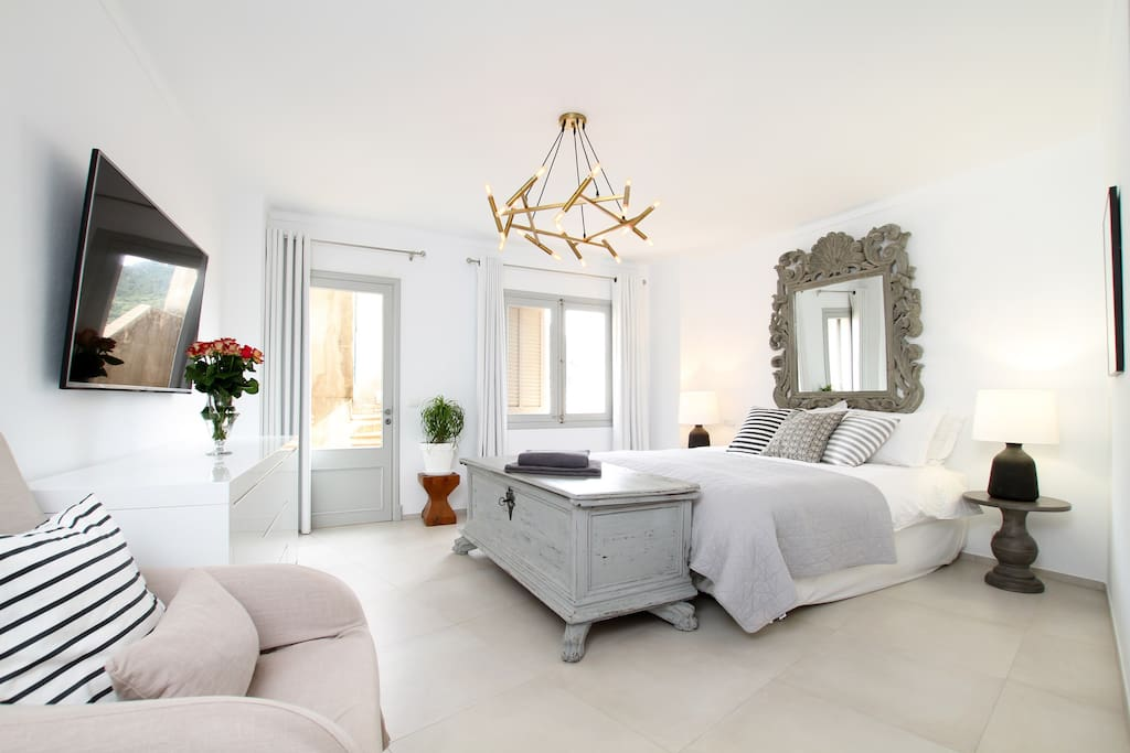 The master bedroom and out to the top terrace