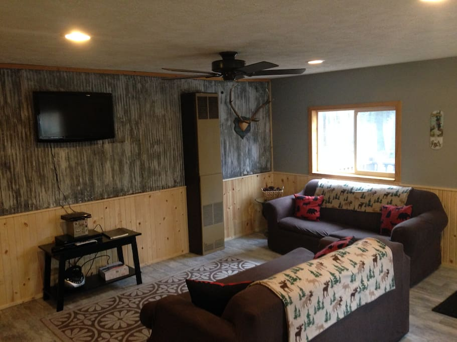 Comfortable living room with flatscreen TV. Also has Direct TV and DVD.