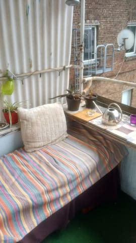 Comfortable bench on the balcony