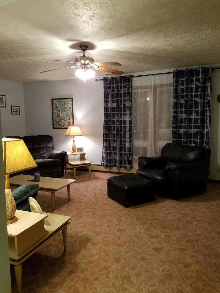 Spacious and light, the living room is a beautiful gathering space. Possibly an extra space for sleeping guests too.