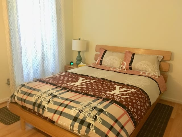 Bedroom with comfy queen bed and linens provided