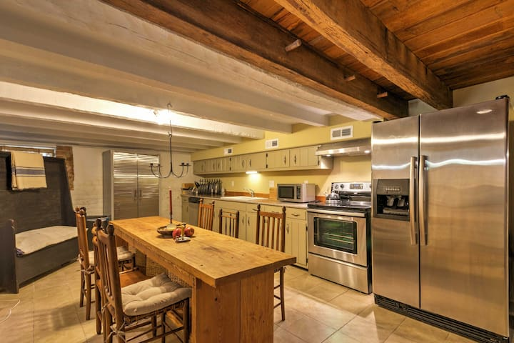 Downstairs, there is a full kitchen and beautiful wood dining table.