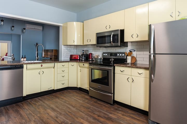 Original Youngstown New York Kitchen cupboards welcome you in this fully equipped kitchen.