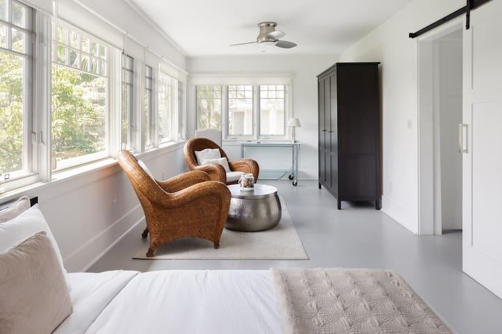 Sunroom bedroom with ocean views