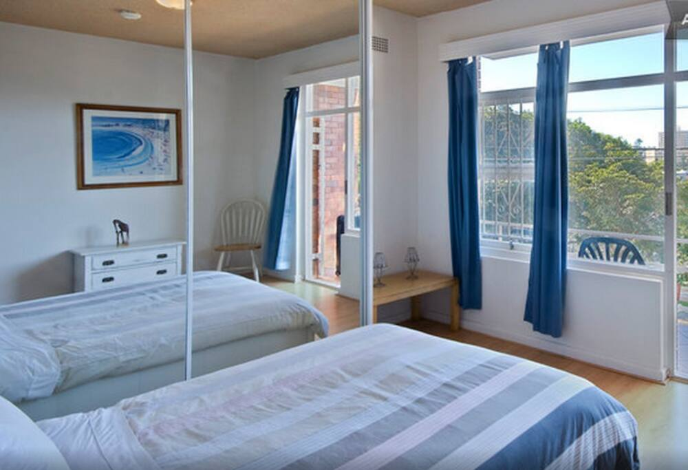 Lovely bright bedroom opening out on to balcony with sunrise views.