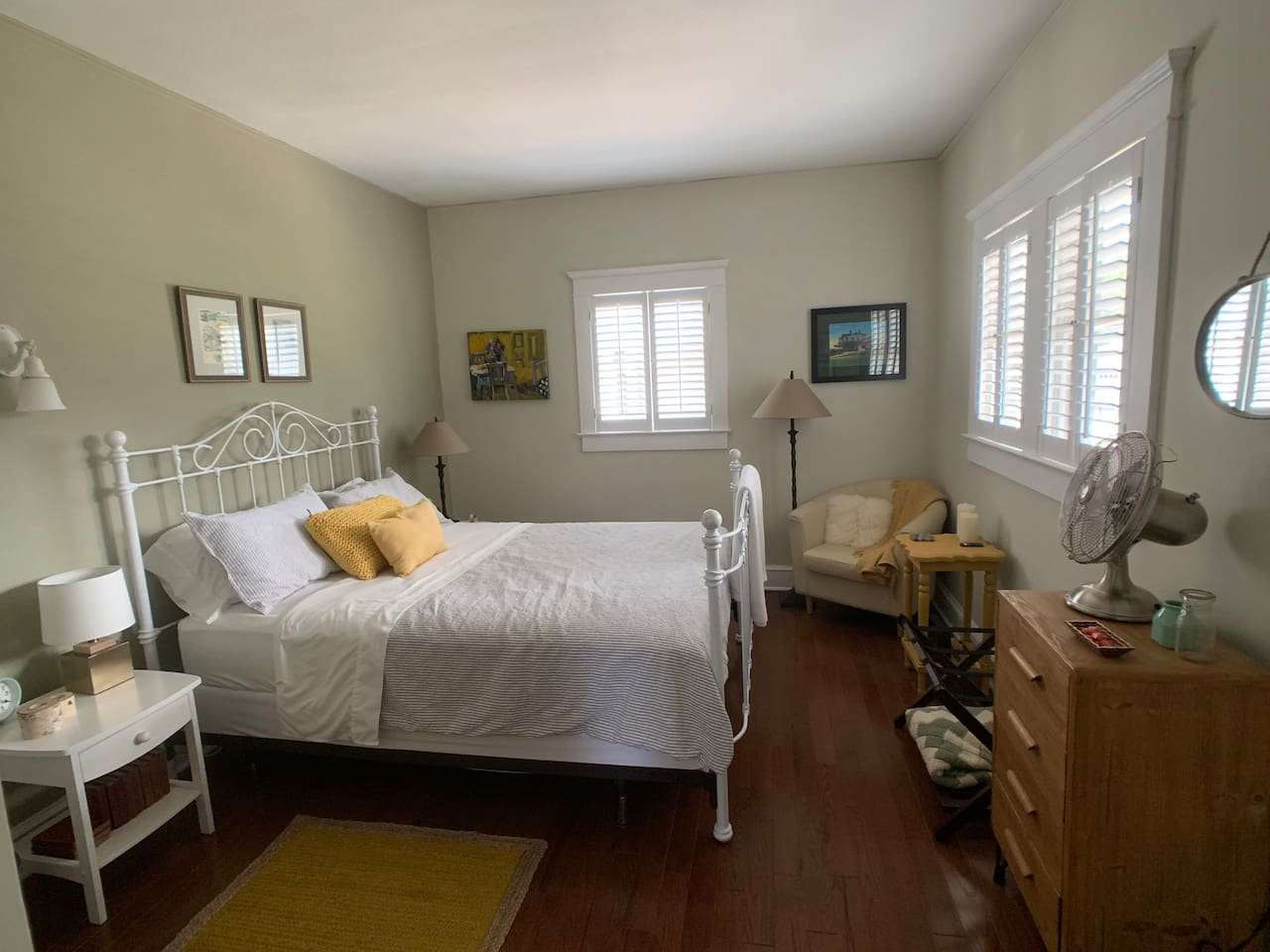 Your guest bedroom with queen size bed, side chair, fan, reading light in drawer as well as a few other fun things you will see if you book.