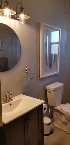 Large main bathroom has everything you need to get ready for the day or unwind for bed
