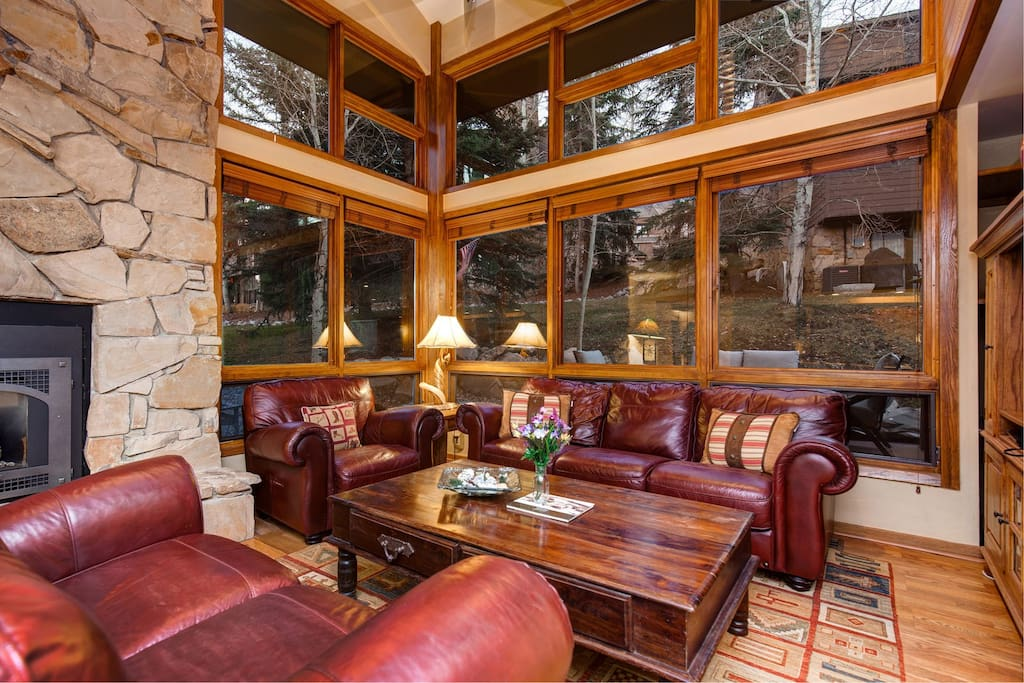 Spacious living area with stone fireplace
