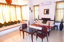 This large well ventilated room is decorated with ethnic Rajasthani artwork and has a panoramic view of the city from its huge window. The room has all the modern amenities with a king sized bed and and a large jharokha to relax on like royalty.