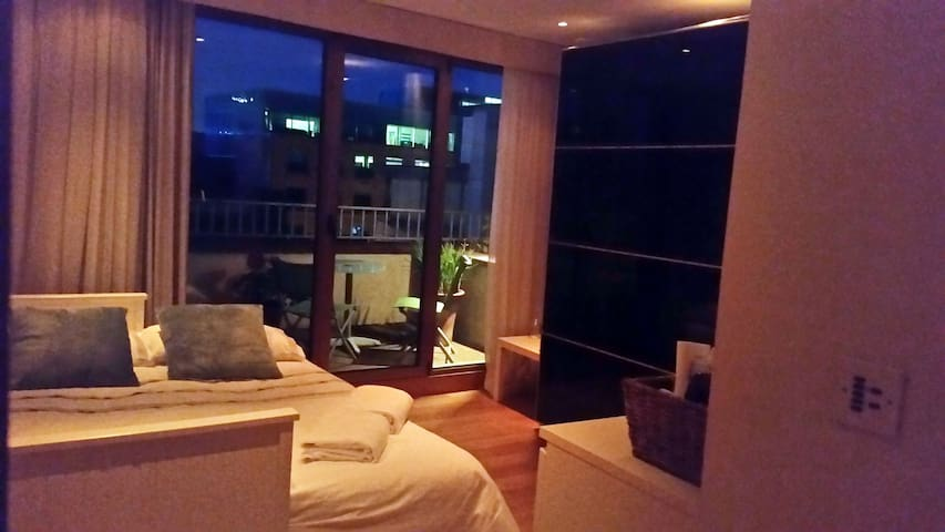 Dimmer Control Night lighting with balcony lighting featuring seating area