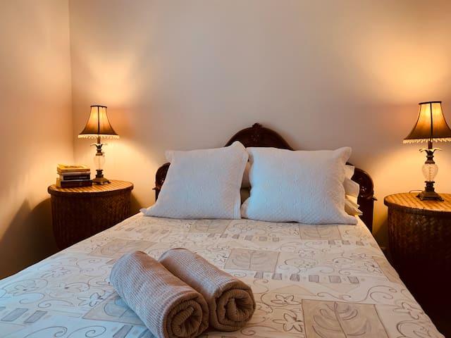 Over sized and elegant queen bedroom