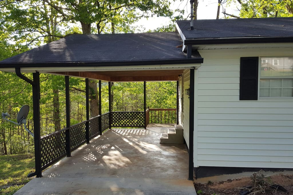 single carport leading to the deck