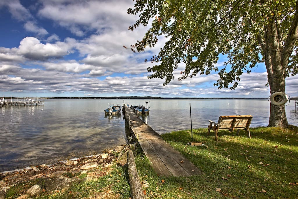 The home is situated just steps from Burt Lake, where you can go swimming, boating and fishing!