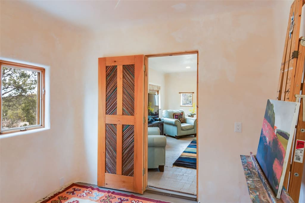 From the Artist's studio looking to the living room past the traditional hand made Santa Fe reed door.