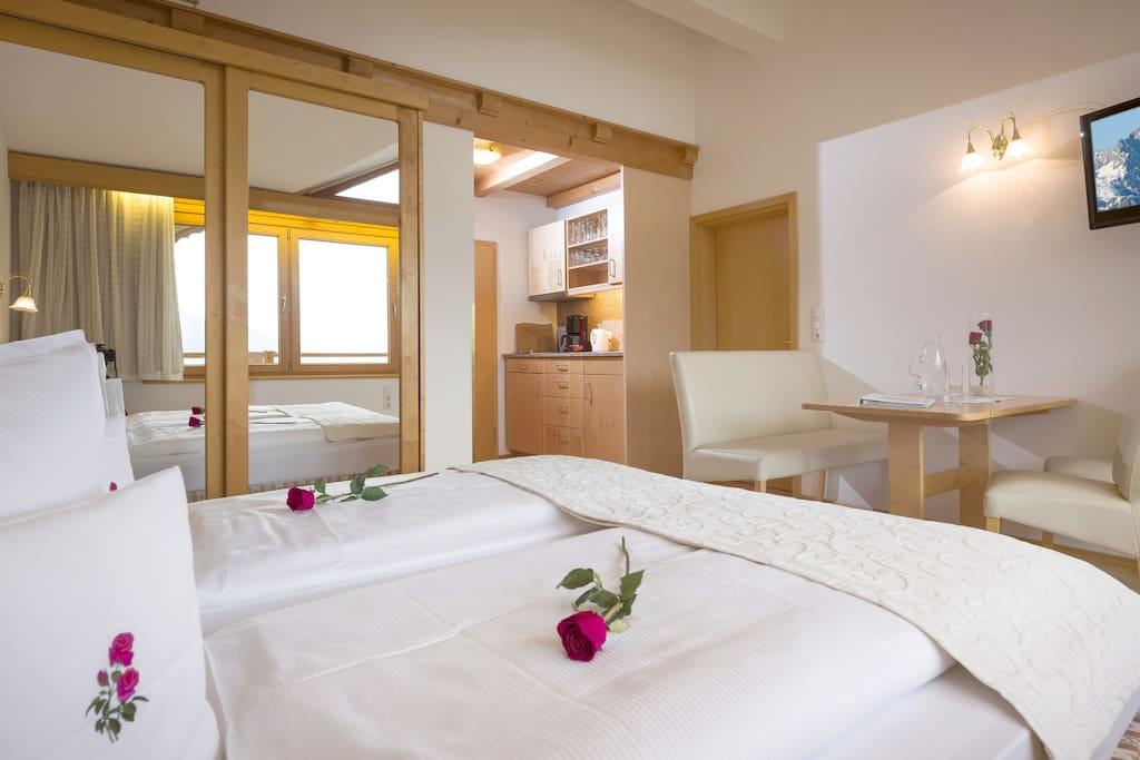 Gartenhotel Rosenhof - Hotel/Ferienwohnungen/Ferienhäuser _Wohn/Schlafraum