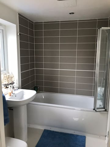 Private bathroom with Shower/Bath, toilet and sink. Amenities provided