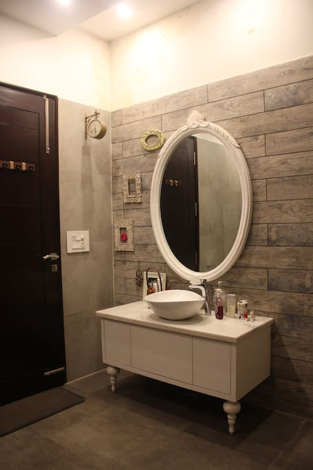 This is the attached bathroom with access to a dressing area.