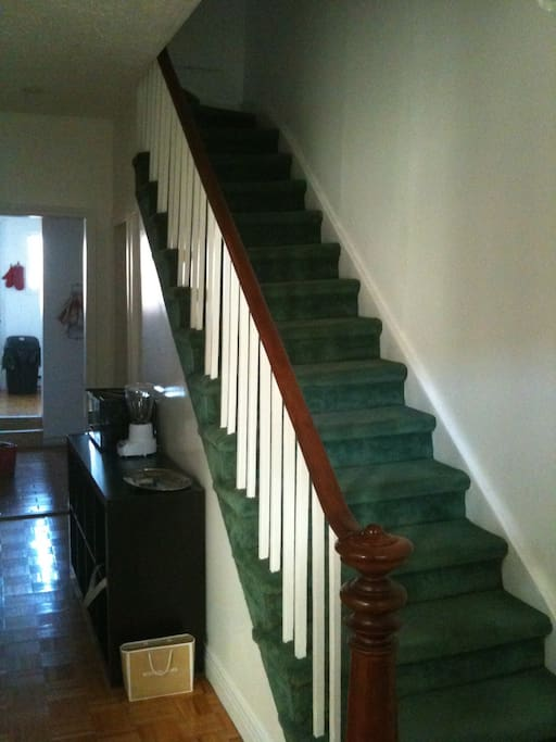 Second floor corridor and staircase (kitchen in the back)