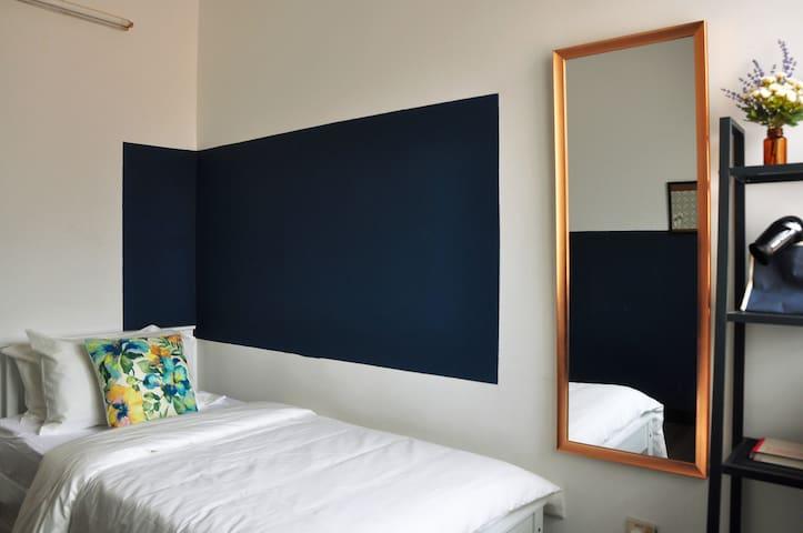 Bedroom 02; single bed with floor mattress.