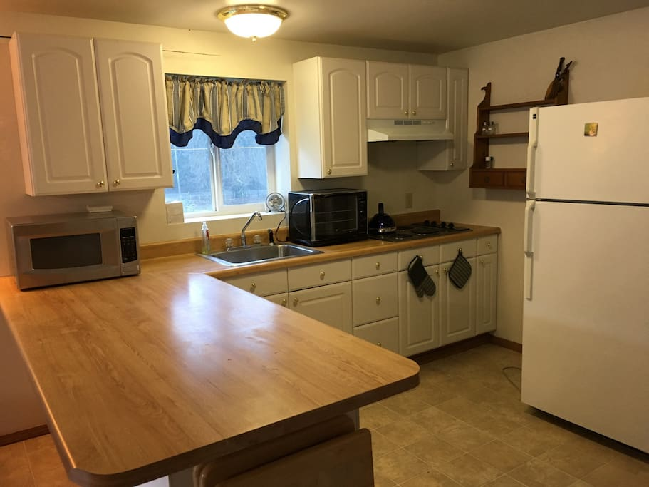 Kitchen, mostly furnished. Counter top oven (it takes small pizzas).