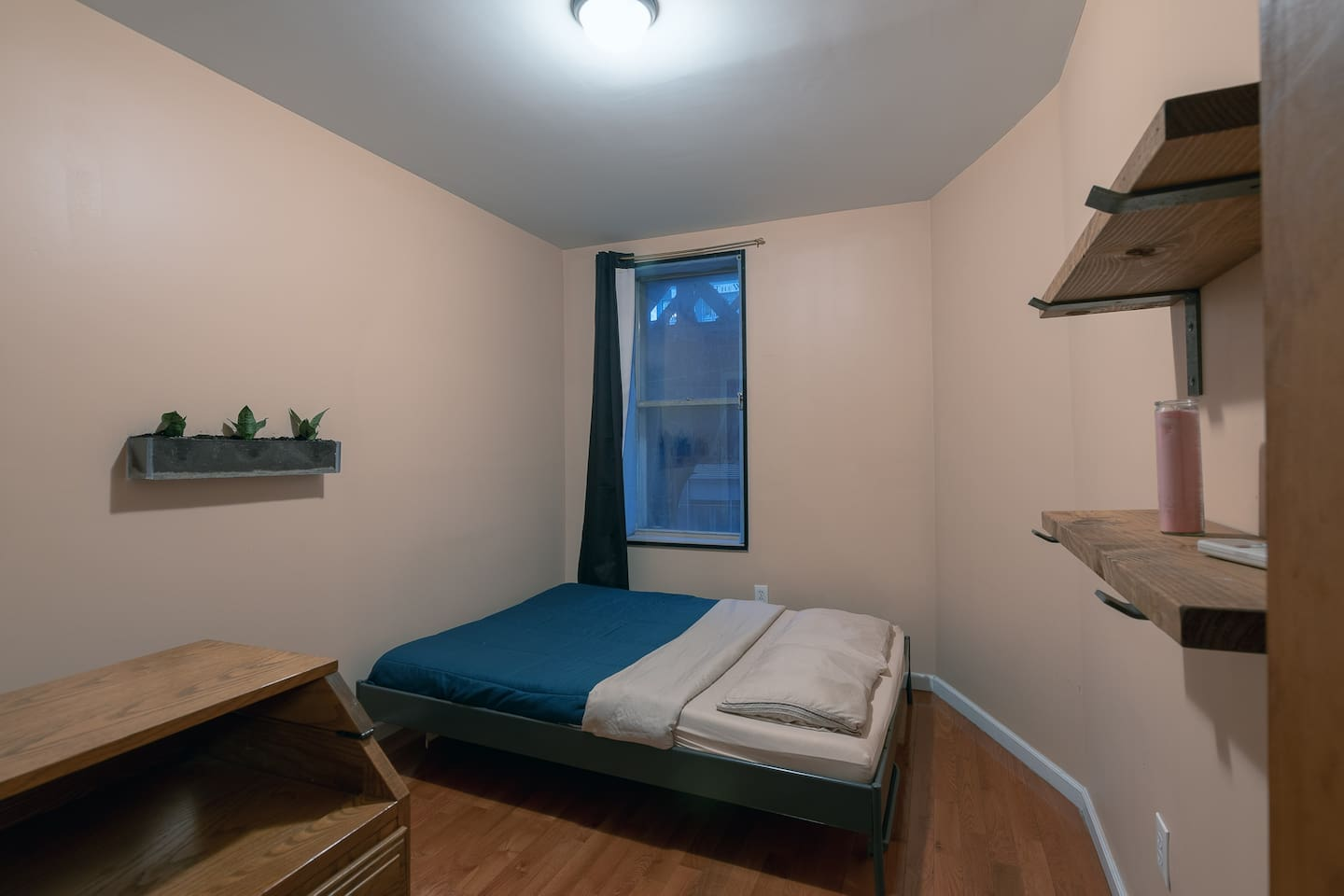 Queen size bed with clean bedsheets and towels provided