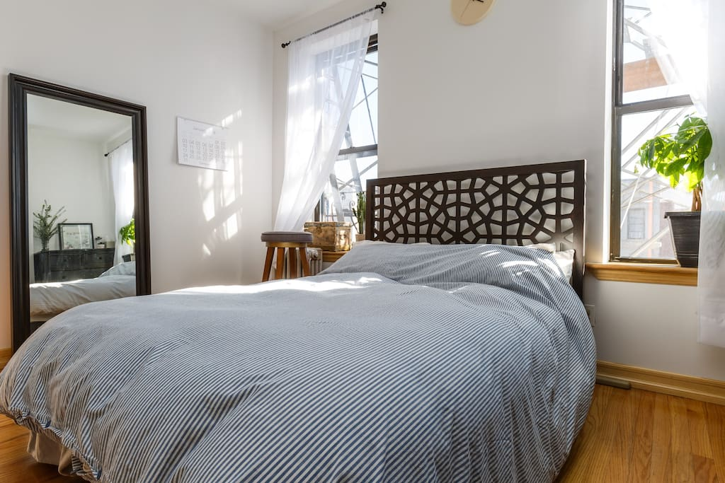 Full length mirror, full-sized bed with true down comforter, two large windows, fire escape (if you're feeling adventurous and want an outdoor seat)