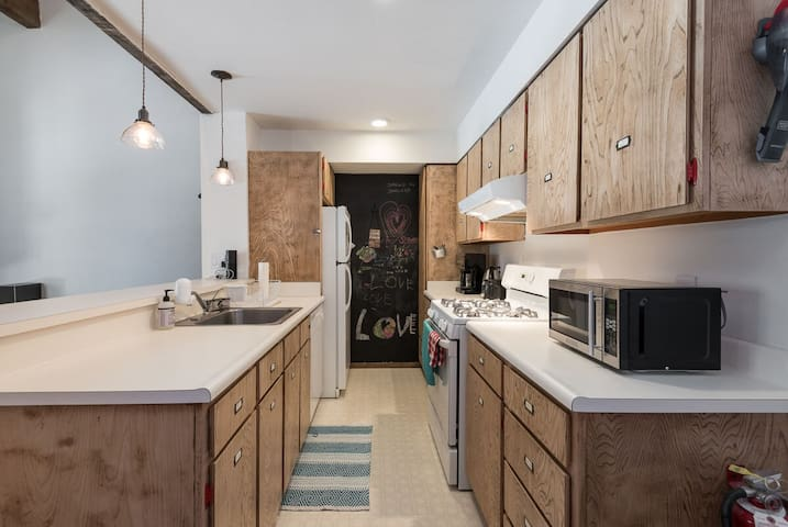 kitchen has gas stove and dishwasher