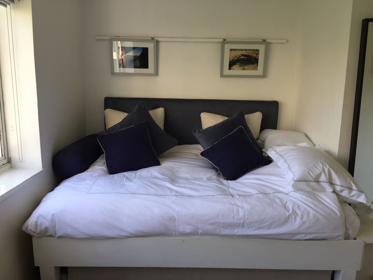 Super comfortable raised double bed .