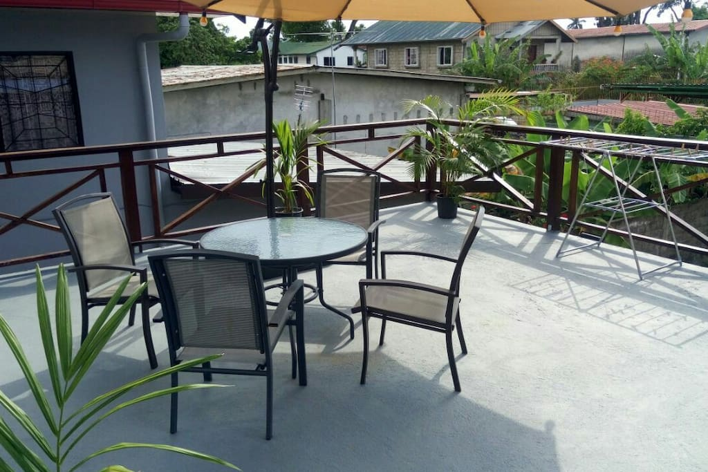Terrace with outdoor dining and relaxation area.