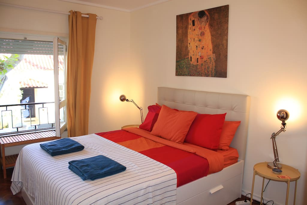 Double bedroom with red bed linen