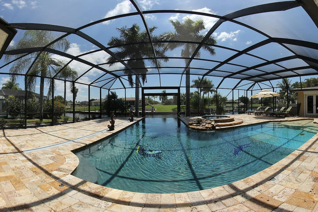 designer pool with infinity edge and plenty of room to relax on 600 sqm patio/pool area