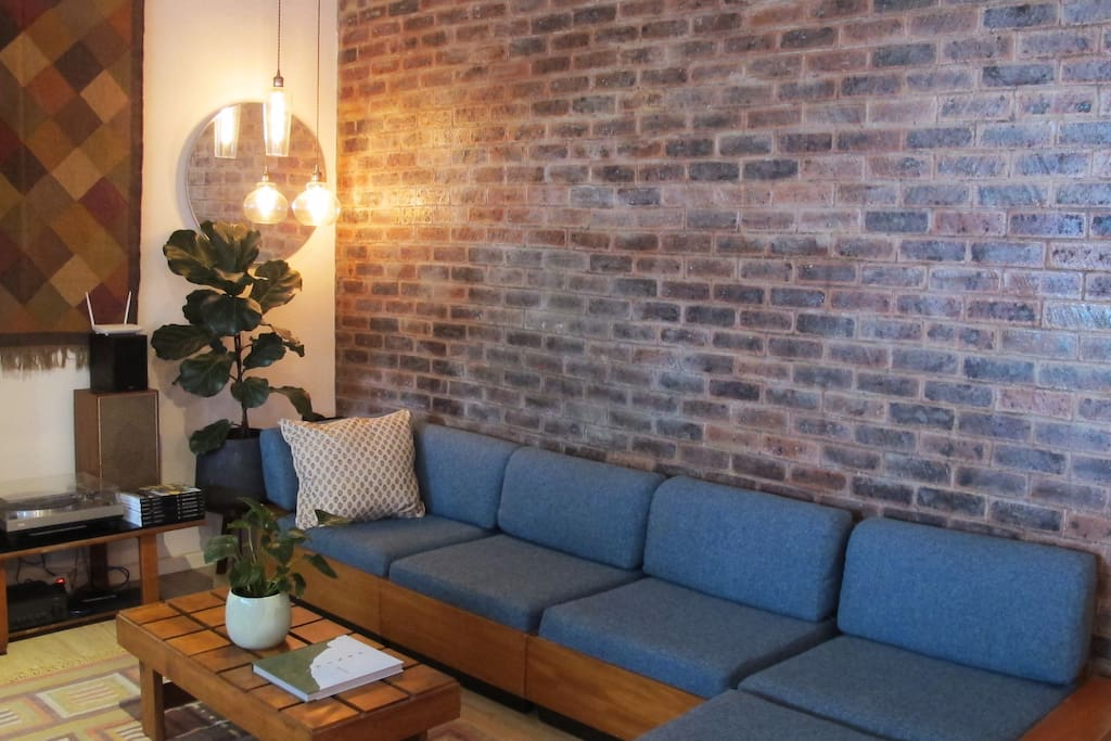 Comfy living room with ample seating and stereo