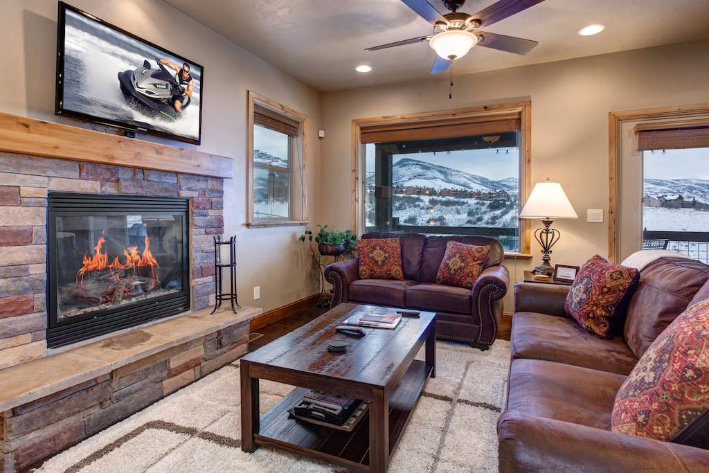 Main Level Great Room - Large HD TV, seating, gas fireplace, ceiling fan, balcony access