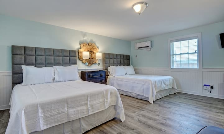 Double Queen Room at Loggerhead Inn by Carolina Retreats
