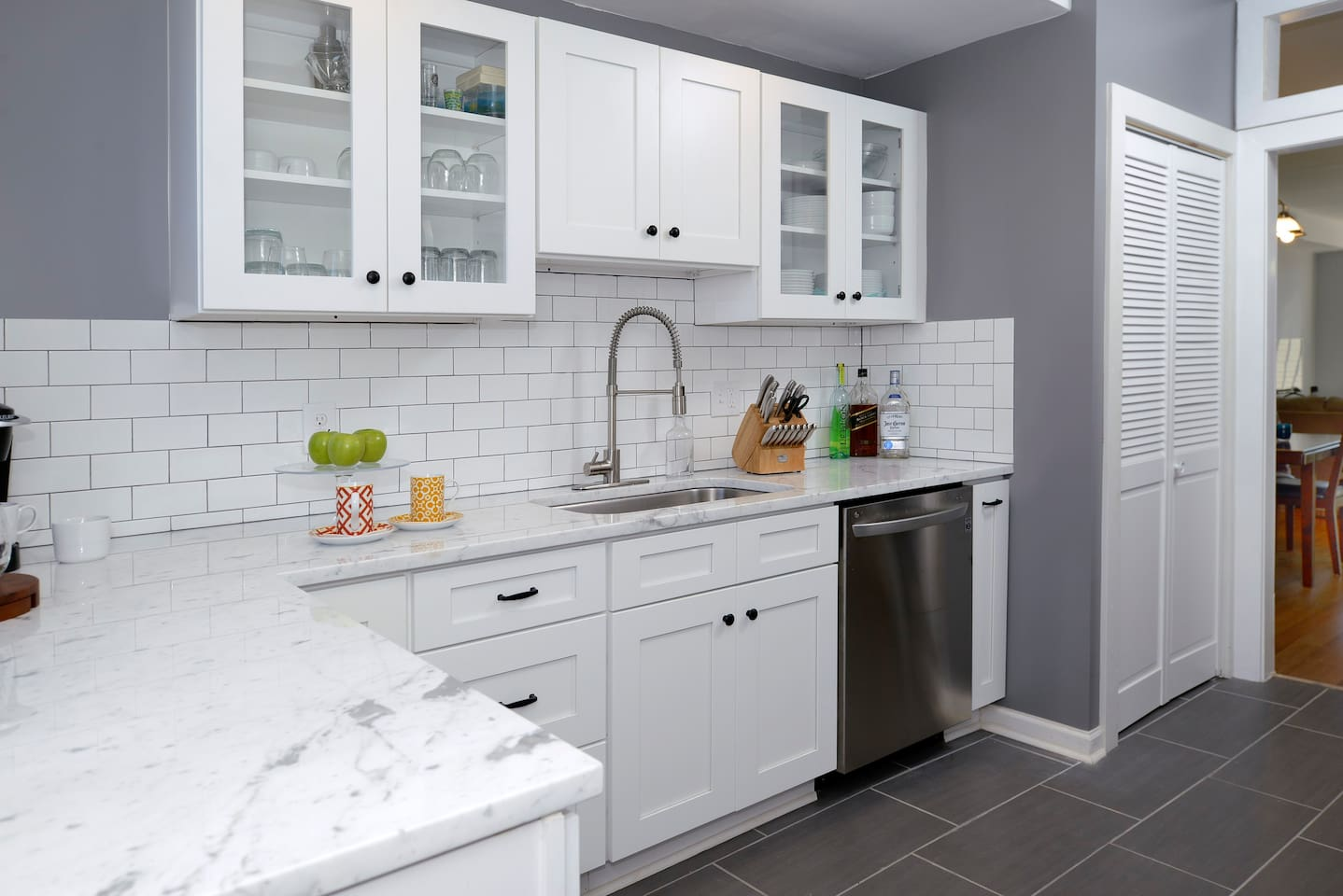beautiful redone kitchen complete with a kurig coffee machine and an assortment of coffee pods!