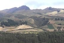 View on inactive volcano Ruminahui (4.721 m) and behind it the highest active volcano of the world: Cotopaxi (5.897 m), situated 55 km south of Quito