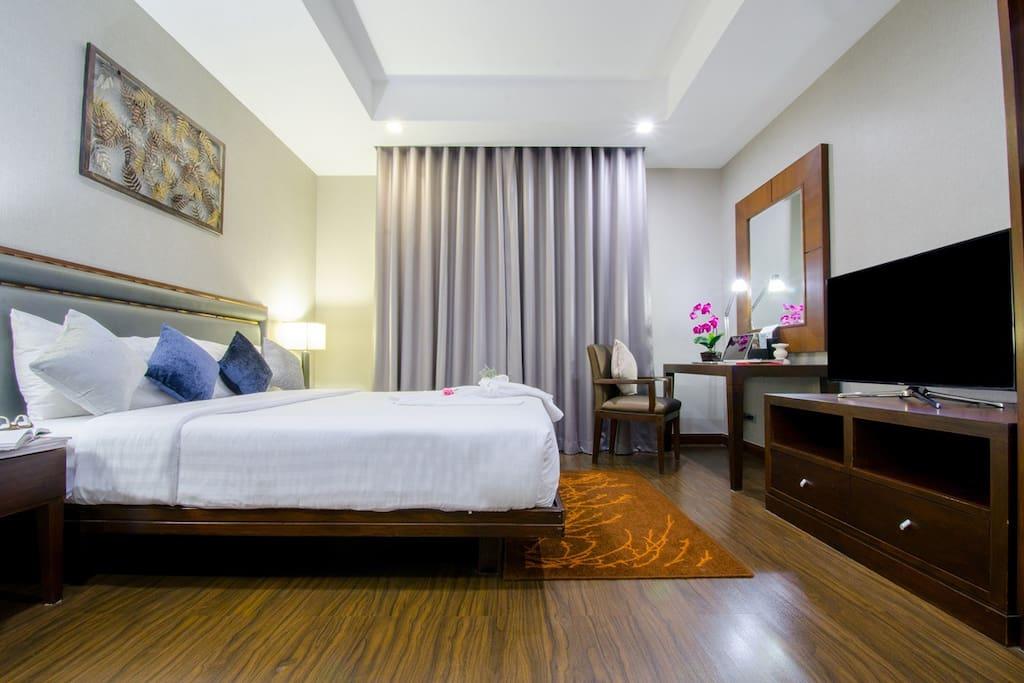 Bedroom with Flat Screen TV