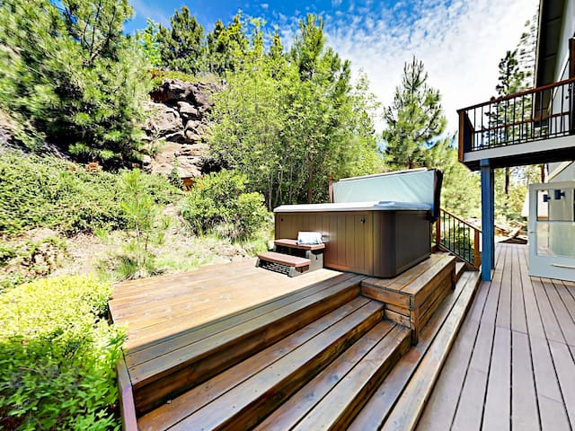 The private hot tub is nestled next natural rimrock outcroppings, providing added seclusion.
