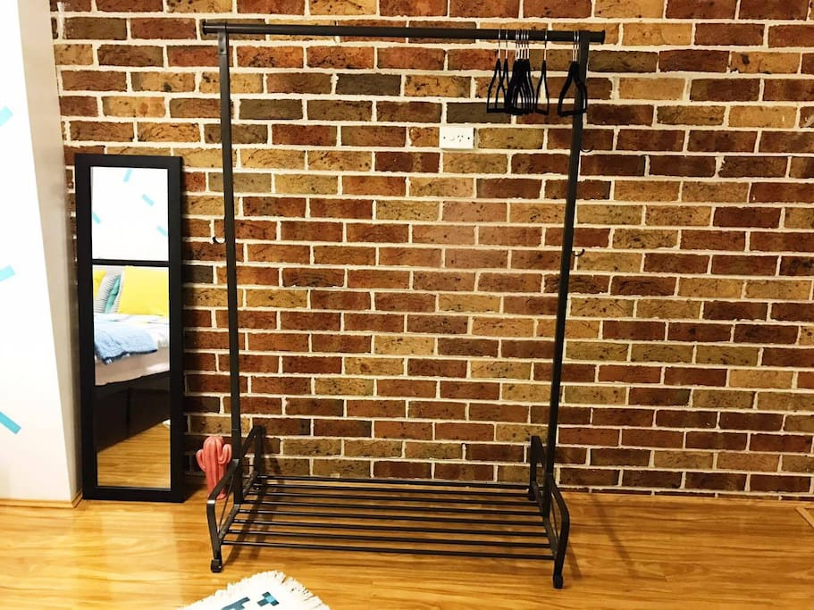 A clothes rack for you to hang whatever you like! Clothe-hangers are at the ready, and more can be offered if you need them.