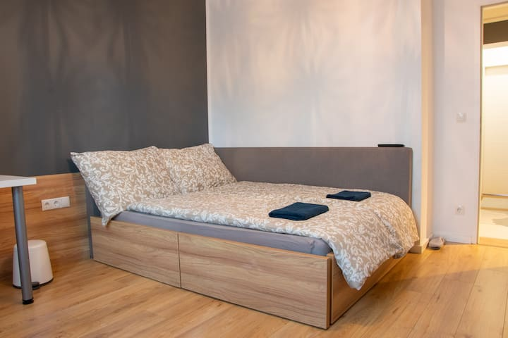 Comfortable Queen Size Bed with best quality mattress, 2 big pillows, 2 sets of covers and blankets.  Big towels and slippers are also provided.