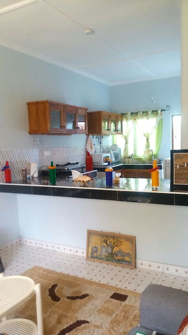 Spacious,clean kitchen where you get to fix your meals and relax at the balcony too